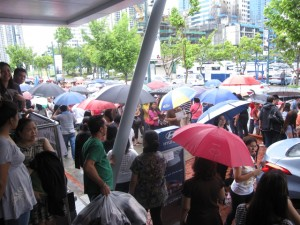 Rain, rain go away! Crocs fanatics here to stay:) Line outside the waiting tent.