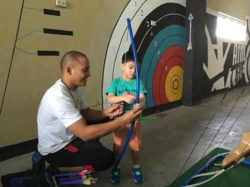 Archery classes are available to kids aged 9 up but Coach Gio willingly indulged my 4 year old to hold a bow.